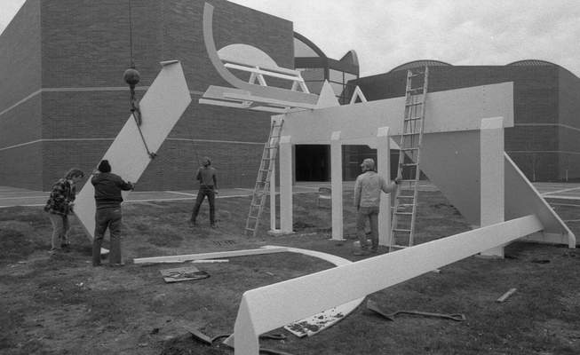 April 9, 1984: Tom Keltch, left, helps sculptor David E. Black and students Richard E. Williams and J. Ryan Nettles assemble Black's Crossings in front of Fort Wayne Museum of Art several days before the building's dedication. (Journal Gazette file)