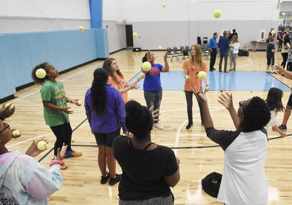 Rachel Von Stroup   The Journal Gazette Kayla Malmgren, right, and Elizabeth Stockbridge, third from right, with the International Jugglers Association, instruct kids Tuesday  at the Boys and Girls Clubs of Fort Wayne.