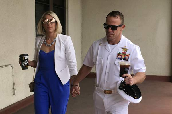 Associated Press Navy Special Operations Chief Edward Gallagher walks with his wife, Andrea Gallagher, as they arriveWednesday at military court on Naval Base San Diego.