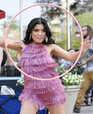 Photos by Rachel Von Stroup | The Journal Gazette Maria Nava performs with a hula hoop during Buskerfest on Saturday. Buskerfest is a celebration of the street performer and features a variety of local, regional and national acts.