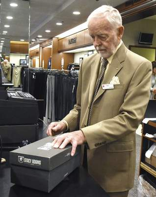 Michelle Davies | The Journal Gazette New Haven City Councilman Terry Werling, 80, works at Macy's in Glenbrook Square.