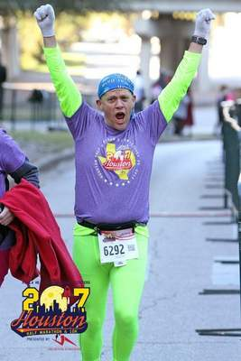 Courtesy photos  Frank Murphy, president of the Fort Wayne Running Club, competed in the Houston Half Marathon in 2017. Murphy convinced his family to join him.