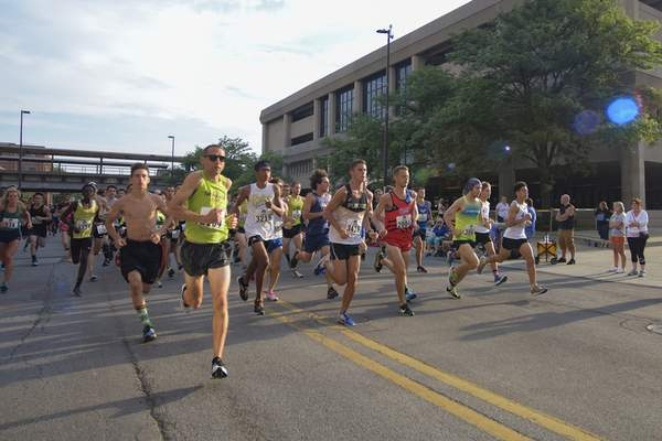 Mike Moore | The Journal Gazette Hundreds of runners take to the streets for the 24th Annual Runners on Parade 5K marathon during the Three Rivers Festival Saturday morning.