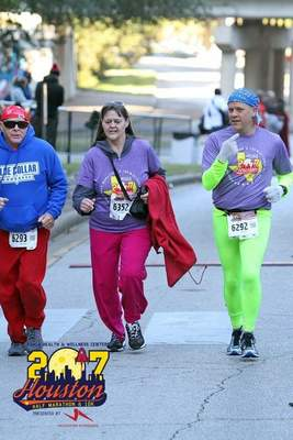 Courtesy photos  From left to right: Fred Murphy and his children, LaVonne Schepis and Fred Murphy, run in the Houston Half Marathon back in October 2017.