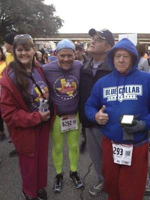 From left, family members LaVonne Schepis, Frank Murphy, Michael Murphy and Fred Murphy pose for a photo at the Houston Half Marathon. Frank Murphy, who was used to running Fort Wayne Trails, said Houston was like another world to him.