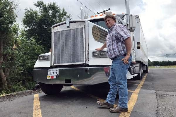 Associated Press photos Terry Button, an independent trucker from upstate New York, is all for loosening rules that regulate how many hours truckers can be on the road in a day.