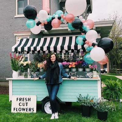 Emma Browning, a 21-year-old University of Saint Francis student, runs Emmie's Flower Cart, selling fresh bouquets and flower crowns. (Courtesy photos)