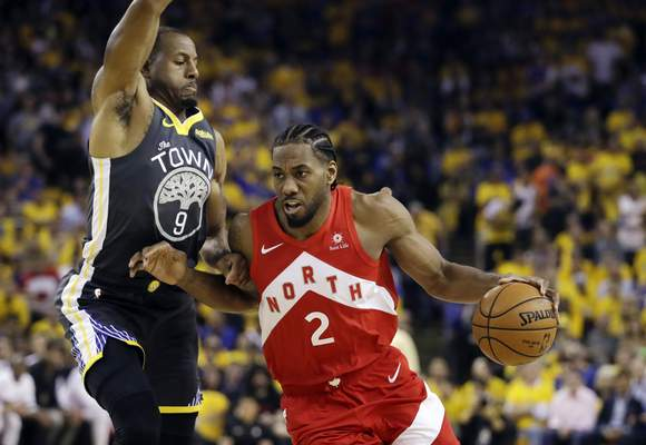 Associated Press  Kawhi Leonard, right, will be leaving the Raptors after bringing Toronto a title. He will be signing instead with the Los Angeles Clippers.