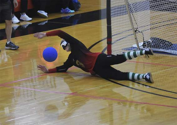 Katie Fyfe   The Journal Gazette Team Lithuania's Justas Pazarauskas blocks the ball during the first half against Team USA during the 2019 IBSA Goalball & Judo International Qualifier at Indiana Tech on Sunday, July 7th, 2019.