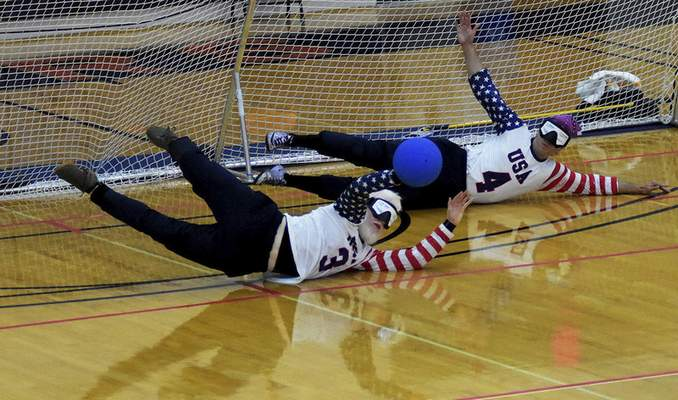 Katie Fyfe   The Journal Gazette  Josh Welborn (left) and John Kusku (right) with team USA defend the goal during the first half against Lithuania during the 2019 IBSA Goalball & Judo International Qualifier at Indiana Tech on Sunday, July 7th, 2019.