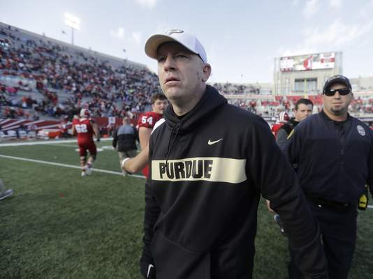 Associated Press Purdue football coach Jeff Brohm spurned Louisville in November to return to the Boilermakers.