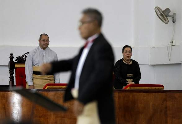 In this April 7, 2019, photo, Tonga King Tupou VI, left, and Queen NanasipauÊ»u TukuÊ»aho, right, attend a mass at the Free Wesleyan Church in Nuku'alofa, Tonga.  (AP Photo/Mark Baker)