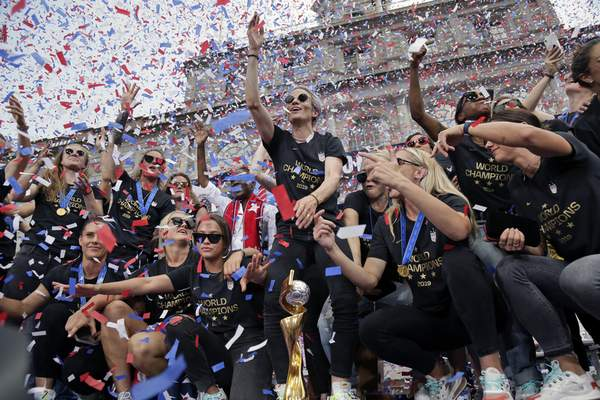 Associated Press The U.S. women's soccer team, including Megan Rapinoe, center, celebrates in downtown Manhattan after a ticker tape parade Wednesday in New York. The U.S. defeated the Netherlands 2-0 to capture a record fourth Women's World Cup title.