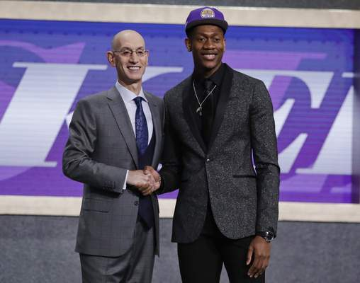 Associated Press Virginia's De'Andre Hunter, right, is greeted by NBA Commissioner Adam Silver after being selected with the fourth pick overall by the Los Angeles Lakers during the NBA draft in New York in June.