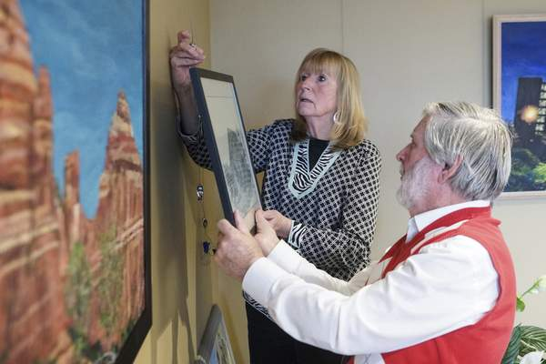 Mike Moore | The Journal Gazette Local artist Jerry Hertenstein hangs a painting at The Heritage Pointe of Fort Wayne retirement community with the help of Nancy Longmate, exhibition chairperson for the Fort Wayne Artists Guild's Exhibitions Program.