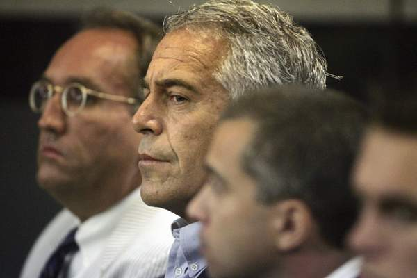 FILE - In this July 30, 2008 file photo, Jeffrey Epstein, center, appears in court in West Palm Beach, Fla. (Uma Sanghvi/Palm Beach Post via AP, File)