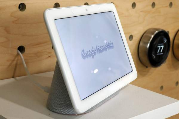 FILE - In this Oct. 9, 2018, file photo a Google Home Hub is displayed in New York. Google contractors are listening to some recordings of people talking to Assistant, either on their phone or through smart speakers such as the Google Home. (AP Photo/Richard Drew, File)