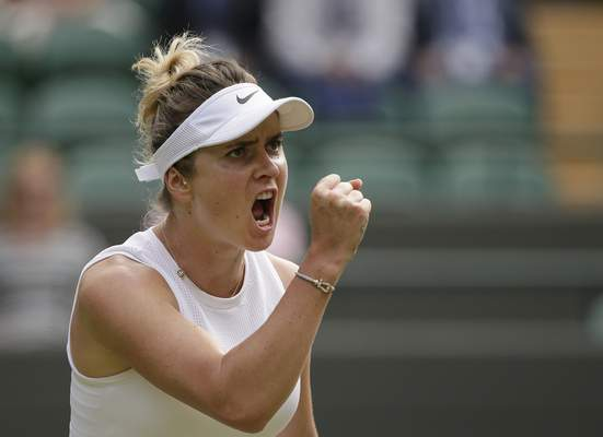 Ukraine's Elina Svitolina celebrates winning a point against Czech Republic's Karolina Muchova during a women's quarterfinal match on day eight of the Wimbledon Tennis Championships in London, Tuesday, July 9, 2019. (AP Photo/Tim Ireland)