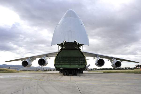 A Russian transport aircraft, carrying military vehicles and equipment, parts of the S-400 air defense systems, is seen at Murted military airport in Ankara, Turkey, Friday, July 12, 2019. The first shipment of a Russian missile defense system has arrived in Turkey, the Turkish Defense Ministry said Friday, moving the country closer to possible U.S. sanctions and a new standoff with Washington. The U.S. has strongly urged NATO member Turkey to pull back from the deal, warning the country that it will face economic sanctions. (Turkish Defence Ministry via AP, Pool)