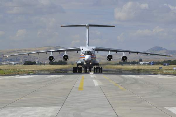 A Russian transport aircraft, carrying parts of the S-400 air defense systems, lands at Murted military airport in Ankara, Turkey, Friday, July 12, 2019. The first shipment of a Russian missile defense system has arrived in Turkey, the Turkish Defense Ministry said Friday, moving the country closer to possible U.S. sanctions and a new standoff with Washington. The U.S. has strongly urged NATO member Turkey to pull back from the deal, warning the country that it will face economic sanctions. (Turkish Defence Ministry via AP, Pool)