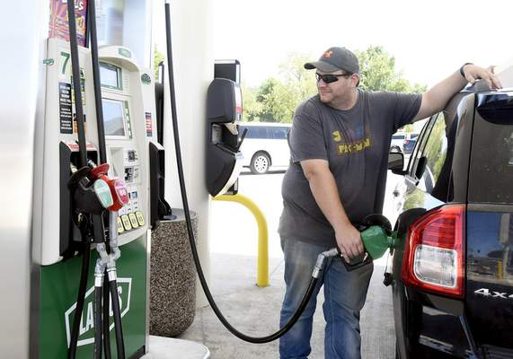 Photos by Rachel Von Stroup | The Journal Gazette Spencer Heimann fills up his tank Friday at the Lassus gas station and convenience store at 901  Coliseum Blvd. W., which has reopened after a $2 million upgrade and expansion.