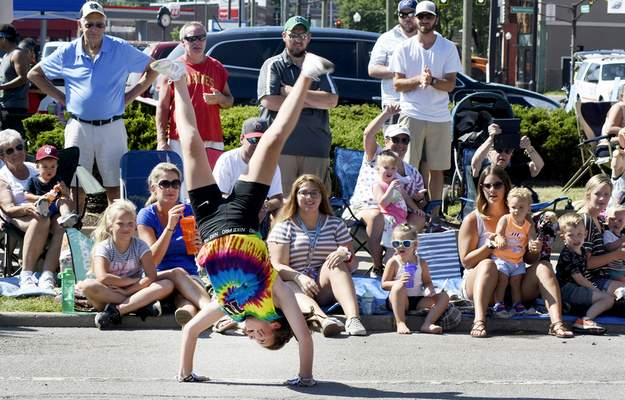 Photos by Rachel Von Stroup | The Journal Gazette A  member of Indiana Ultimate wows the crowd with a  flip during Saturday's Three Rivers Festival Parade.