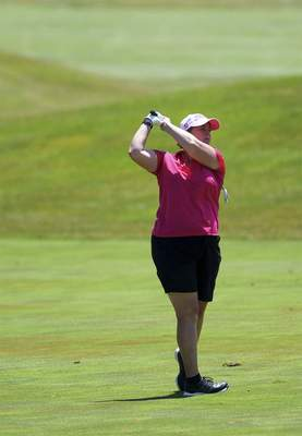 Katie Fyfe | The Journal Gazette Lori Stinson hits on the sixth hole in the second round of the Women's City Golf Tournament at Autumn Ridge Golf Course on Saturday.