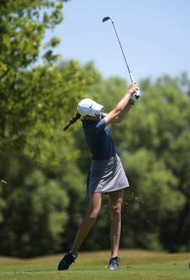 Katie Fyfe | The Journal Gazette  Danica Swaggerty follows through her swing on the seventh hole during the second round of the Women's City Golf Tournament at Autumn Ridge Golf Course on Saturday.