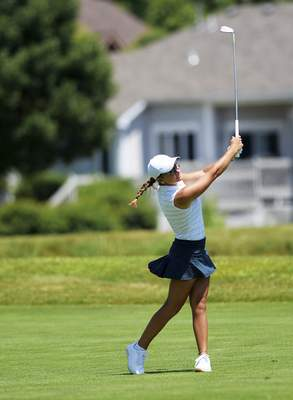Katie Fyfe | The Journal Gazette  Morgan Dabagia hits the ball on the ninth hole during the second round of the Women's City Golf Tournament at Autumn Ridge Golf Course on Saturday.