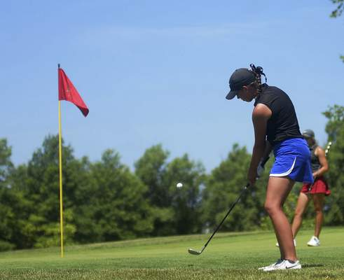 Katie Fyfe | The Journal Gazette  Betsy Schroeder chips the ball on the second hole during the second round of the Women's City Golf Tournament at Autumn Ridge Golf Course on Saturday.
