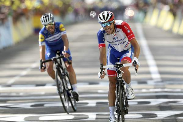 Associated Press Thibaut Pinot, right, and Julian Alaphilippe cross the finish line of the eighth stage in Saint Etienne, France, on Saturday.