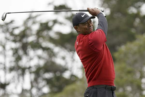 Associated Press  Tiger Woods watches his tee shot during the final round of the U.S. Open Championship  in Pebble Beach, Calif. Woods has played just three tournaments since he won the Masters.