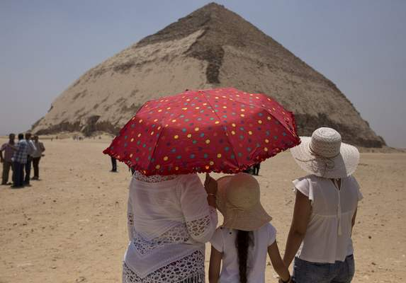 Associated Press Women visit the Bent Pyramid on Saturday in Dashur, Egypt, as the country reopened the pyramid and its satellites for visitors.