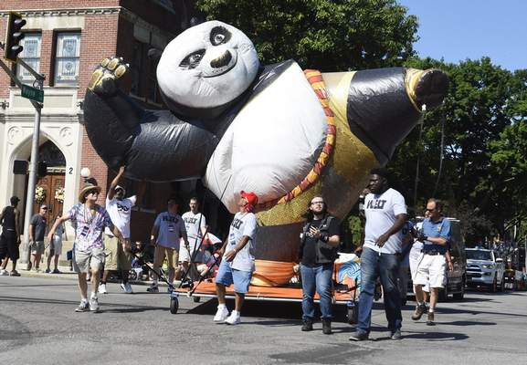 The panda float sponsored by Allen County Public Library Community Radio WELT-FM 95.7 makes its way along Wayne Street.
