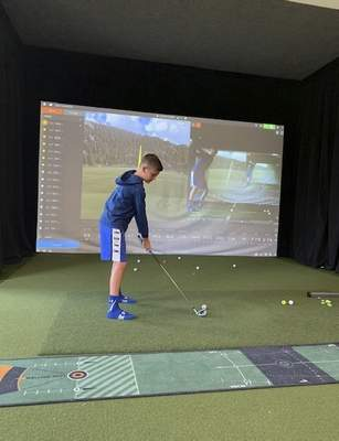 The Snyder family didn't expect golf to become such a big part of their lives, but after Landon's success, they installed a golf simulator at their Roanoke home.