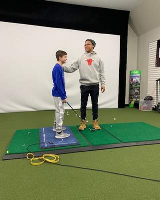 Courtesy photo  Landon Snyder taking lessons with his coach, Albert Jennings, at APEX Golf Lab.