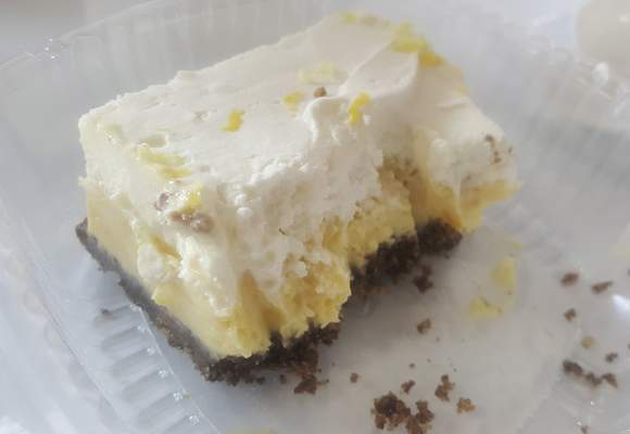 A partially eaten lemon square -- the photographer could not wait -- from Lindi's on Main Street.