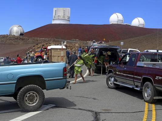 FILE - In this Oct. 7, 2014, file photo, protesters block vehicles from getting to the Thirty Meter Telescope groundbreaking ceremony site at Mauna Kea, Hawaii. (Hollyn Johnson/Hawaii Tribune-Herald via AP, File)