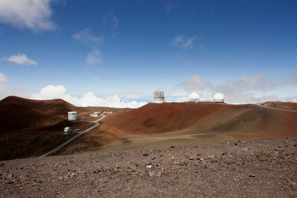 FILE - In this Aug. 31, 2015, file photo, observatories and telescopes sit atop Mauna Kea, Hawaii's tallest mountain and the proposed construction site for a new $1.4 billion telescope, near Hilo, Hawaii. (AP Photo/Caleb Jones, File)