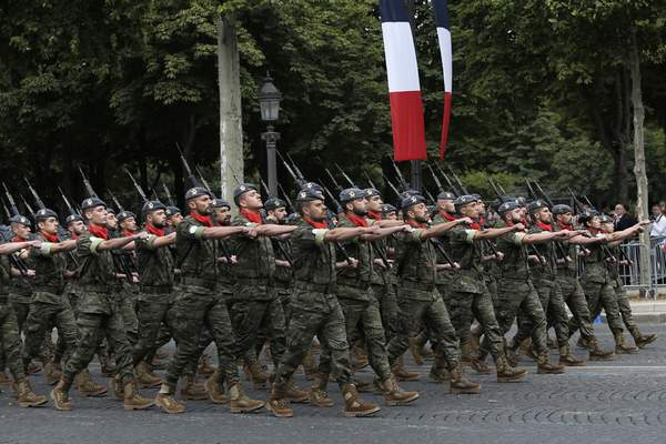Portuguese troops take part to Bastille Day parade Sunday, July 14, 2019 on the Champs-Elysees avenue in Paris. (AP Photo/Rafael Yaghobzadeh)