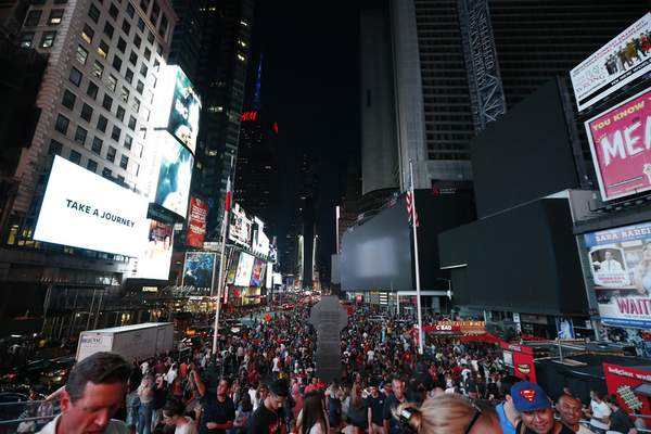 Associated Press Questions and calls for investigations followed Saturday's power outagein New York City.