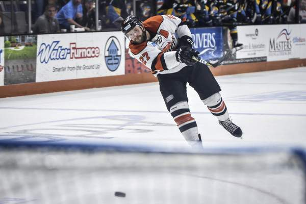 Mike Moore | The Journal Gazette  Shawn Szydlowski nets a game-winning goal for the Komets at Memorial Coliseum.