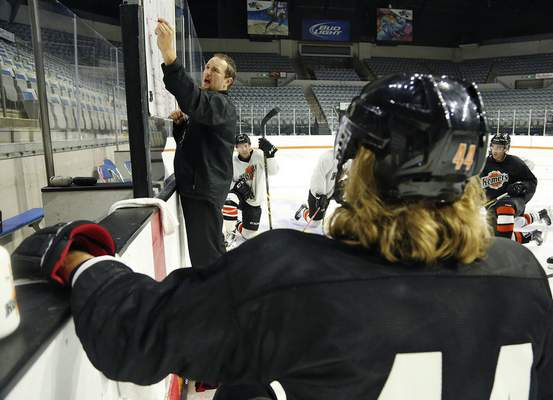File photo  Gary Graham draws up a play during a Komets practice at Memorial Coliseum.
