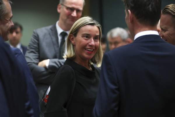 European Union foreign policy chief Federica Mogherini, center, arrives for a European Foreign Affairs Ministers meeting at the European Council headquarters in Brussels, Monday, July 15, 2019. (AP Photo/Francisco Seco)