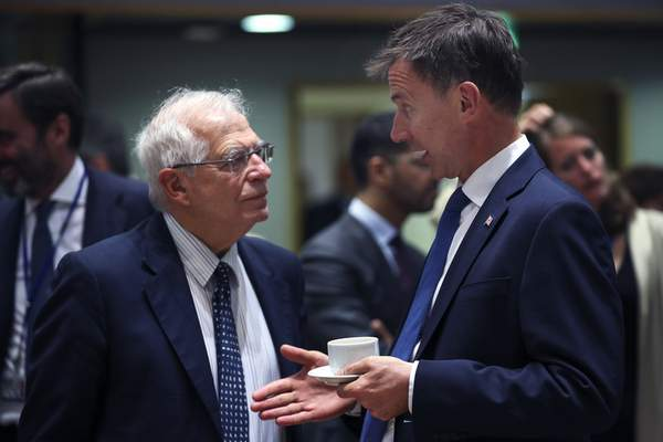 Britain's Foreign Secretary Jeremy Hunt, right, talks to his Spanish counterpart Josep Borrell during a European Foreign Affairs meeting at the European Council headquarters in Brussels, Monday, July 15, 2019. (AP Photo/Francisco Seco)