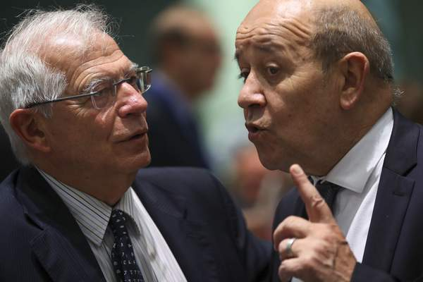 Spain's Foreign Minister Josep Borrell, left, talks to his French counterpart Jean-Yves Le Drian during a European Foreign Affairs Ministers meeting at the European Council headquarters in Brussels, Monday, July 15, 2019. (AP Photo/Francisco Seco)