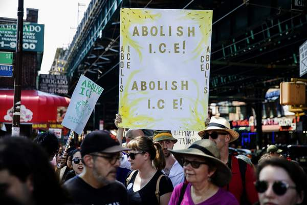 Associated Press  People hold signs calling for the abolition of Immigration and Customs Enforcement at a rally before the start of a march in opposition to the Trump administration's plans to continue with raids to catch immigrants in the country illegally, Sunday, July 14, 2019, in the Queens borough of New York.