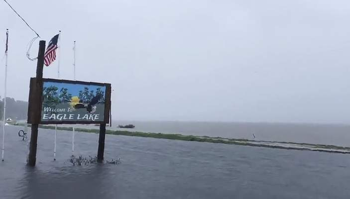 Associated Press  An image made from a cellphone video provided by the Mississippi Governor's Office on Sunday shows the flooded welcome sign at the entrance to Eagle Lake community near Vicksburg, Miss.