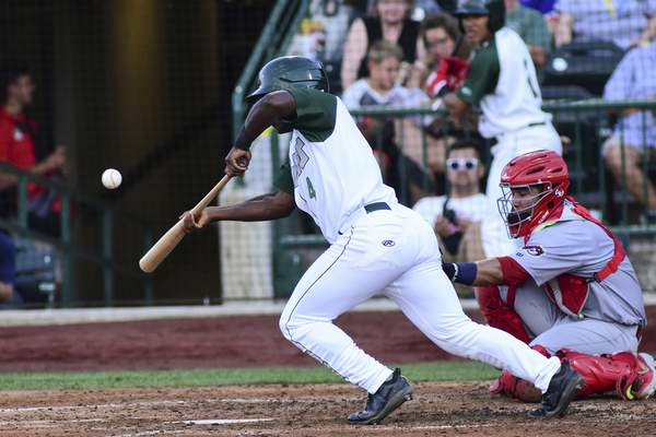 Mike Moore | The Journal Gazette TinCaps designated hitter Lee Solomon bunts in the fourth inning against Peoria at Parkview Field on Wednesday.