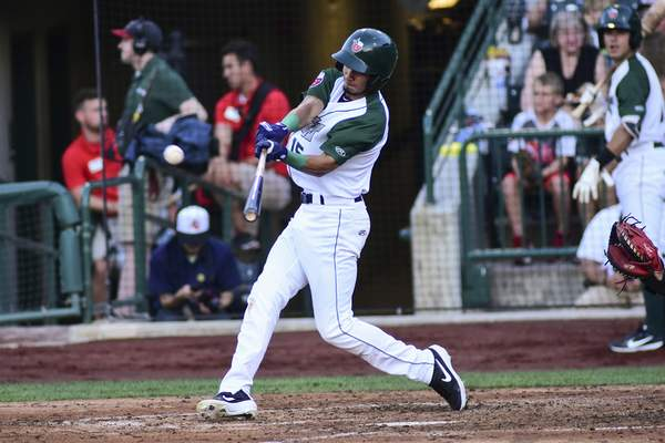 Mike Moore | The Journal Gazette TinCaps second baseman Tucupita Marcano bats in the fourth inning against Peoria at Parkview Field on Wednesday.